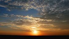 Sonnenuntergang über der Serengeti 11